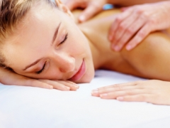 Young lady enjoying a body massage at a spa